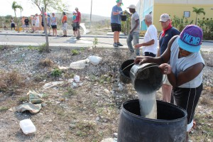 Bucket brigade at Villa Progresso - Working Together!